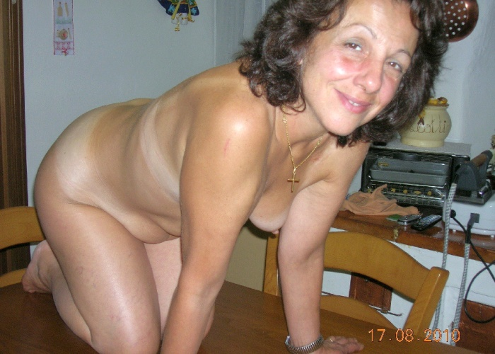 Small Tits Mature nude on the Table